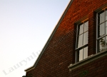 evening building, red brick, windows, digital photography by Lauryn Medeiros