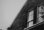 building in the evening, black and white, windows, film print by Lauryn Medeiros, photography